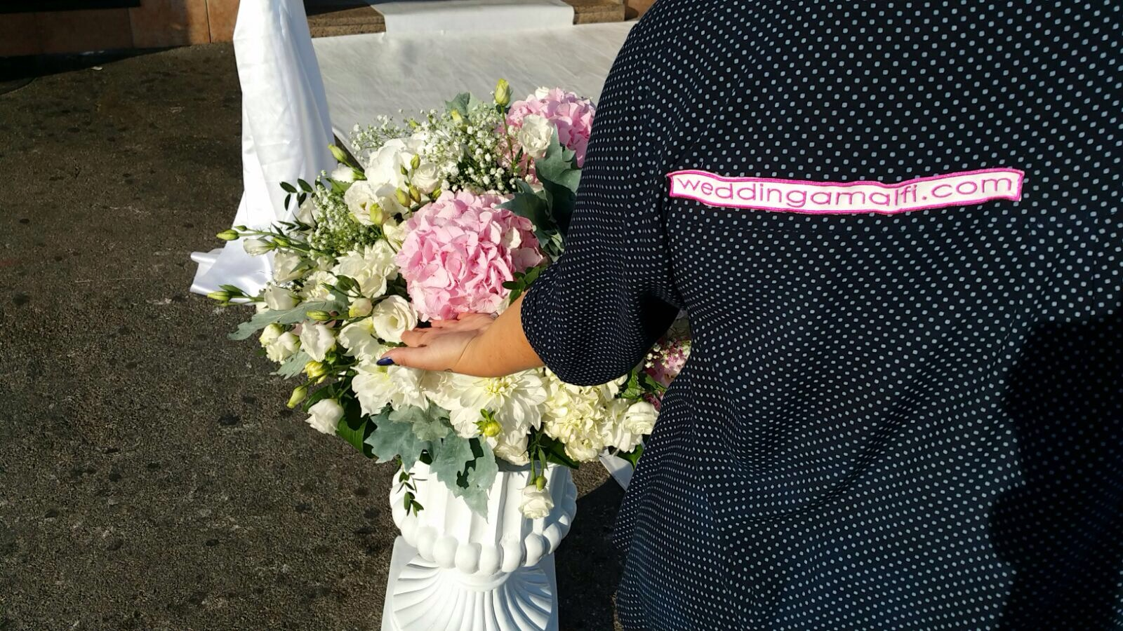 http://www.weddingamalfi.com/wp-content/uploads/Domenico-and-Maria-Wedding-Amalfi-staff-at-work-chairs-decoration.jpg