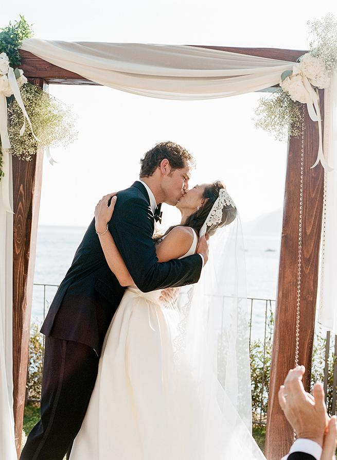 http://www.weddingamalfi.com/wp-content/uploads/bride-groom-kiss-wedding.jpg