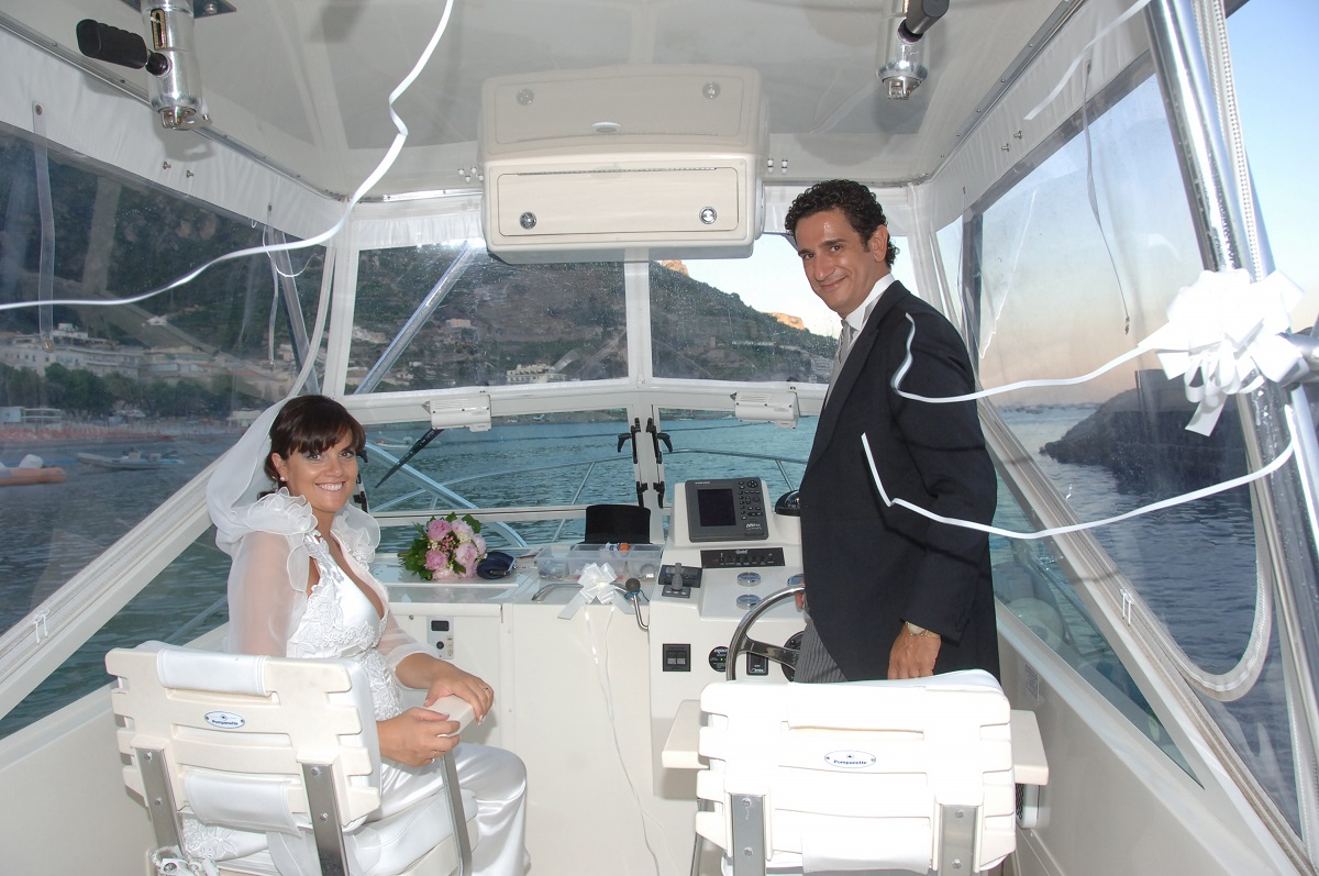 http://www.weddingamalfi.com/wp-content/uploads/the-Amalfi-Coast-wedding-experience-a-boat-ride-at-sunset.jpg