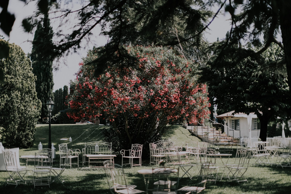 Alessandro and Diego - white chairs for guests in the garden