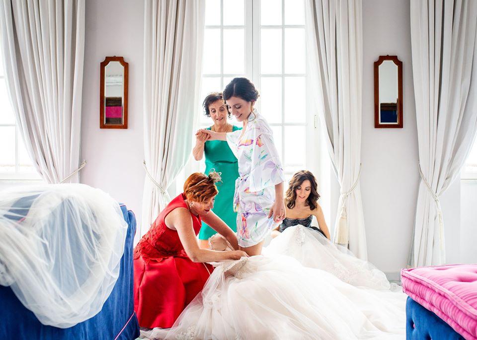 Bride-getting-ready-wearing-the-wedding-dress.jpg