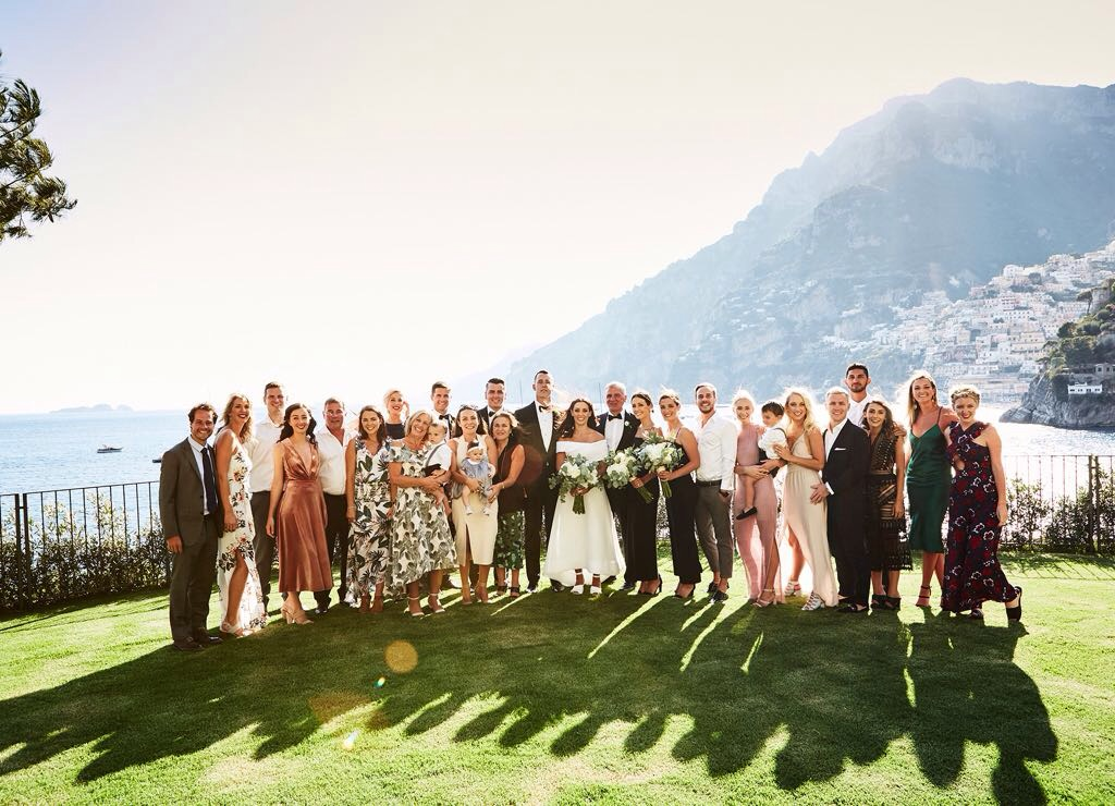 https://www.weddingamalfi.com/wp-content/uploads/Laura-and-Jarrod-bride-and-groom-with-their-guests.jpg