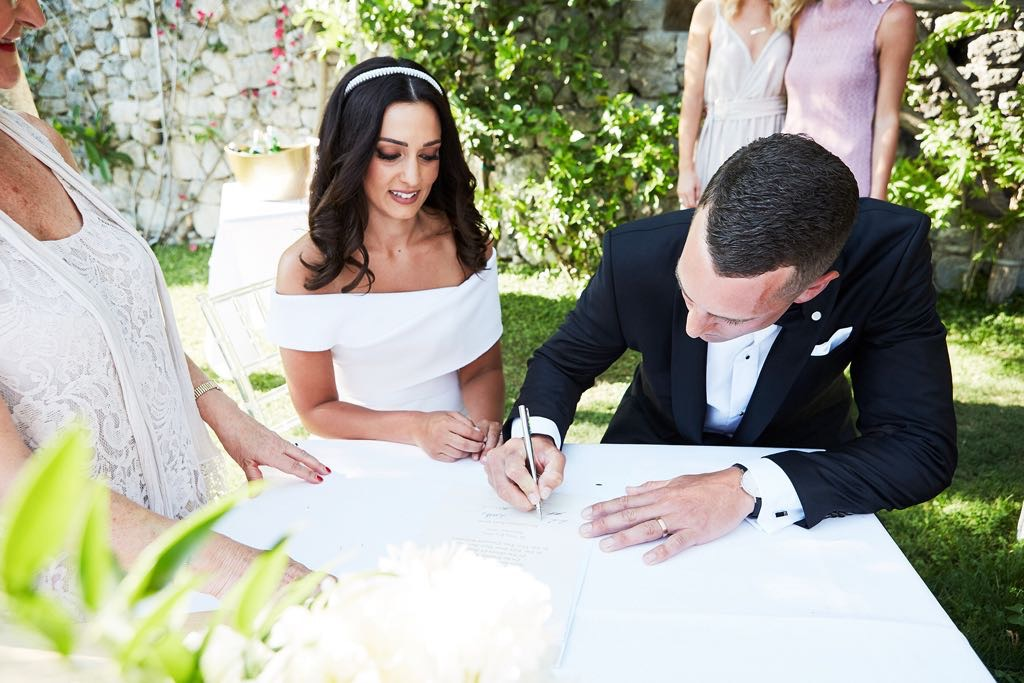https://www.weddingamalfi.com/wp-content/uploads/Laura-and-Jarrod-signing-the-papers.jpg