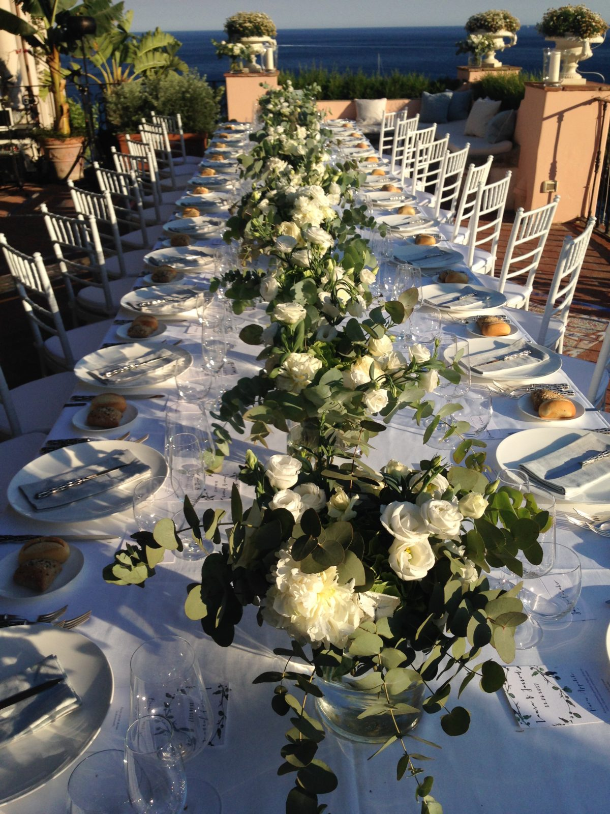 Laura and Jarrod wedding table decorations with fresh flowers