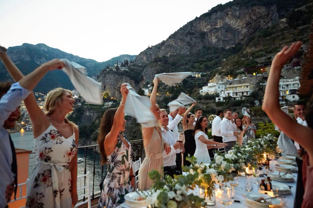 https://www.weddingamalfi.com/wp-content/uploads/Laura-and-Jarrod-with-their-smiling-guests.jpg